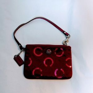 Coach red/burgundy wristlet with sequins